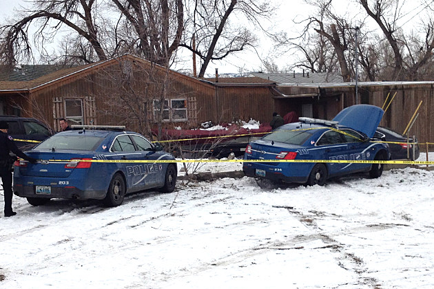 Police investigate the scene of a crash following a robbery attempt and police chase.