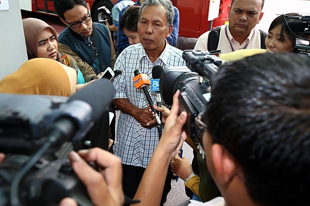 A relative of a Malaysia Airlines flight MH370 passenger speaks to the media