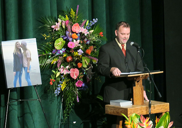 Ben Reeves of the Kingdom Hall of Jehovah's Witnesses congregation in Sheridan speaks at the celebration of life for Aurora Rohrer at Kelly Walsh High School on Saturday.       Tom Morton, Townsquare Media