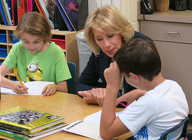 U.S. Secretary of Education Betsy DeVos looks at the work of students at Woods Learning Center in Casper on Tuesday.     Tom Morton, Townsquare Media