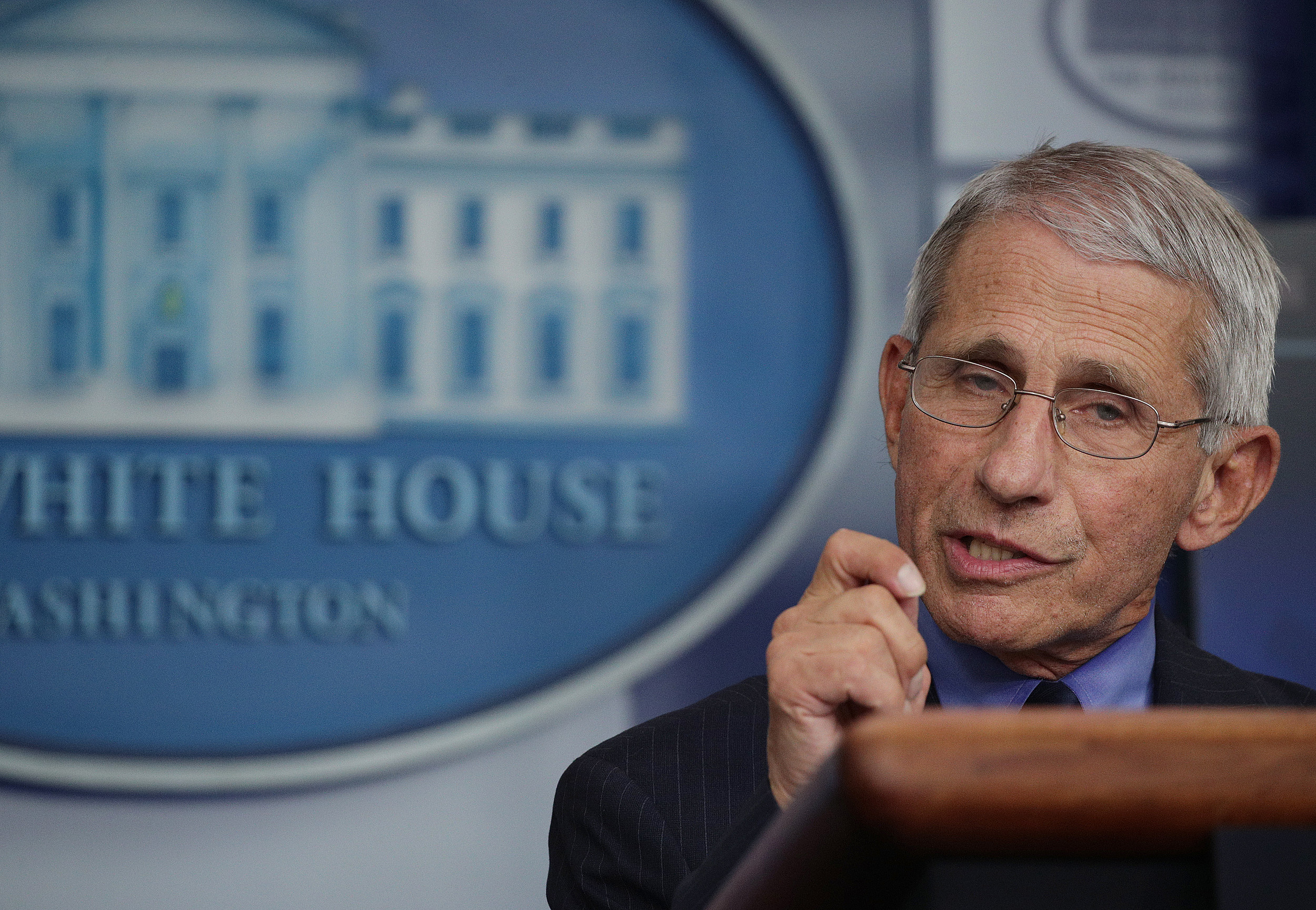 The Latest: Fauci Dismayed by Texas' Move to Ban Mandates